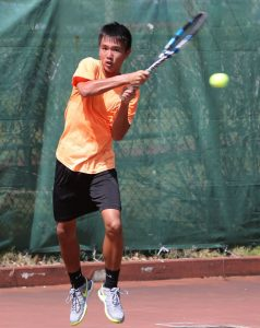 In this photo, Guam's Camden Camacho, plays a backhand return against Kenta Kurita of Japan in a qualifying draw match of the 2017 King's Guam Futures, an ITF Pro Circuit event presented by DOCOMO Pacific and Hilton Guam Resort & Spa at the Hilton tennis courts.  Camacho is one player being considered as a member of Team  Guam's Davis Cup contingent.